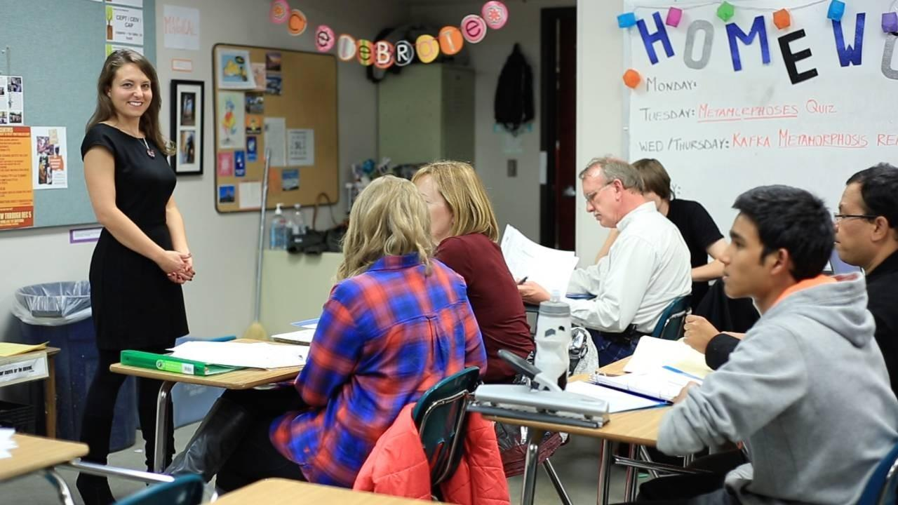 Image shows Sheri Smith giving a presentation to job seekers in a classroom.
