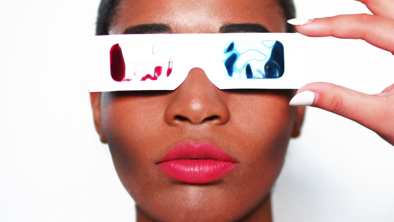 Woman holding 3D glasses to her face as a visionary