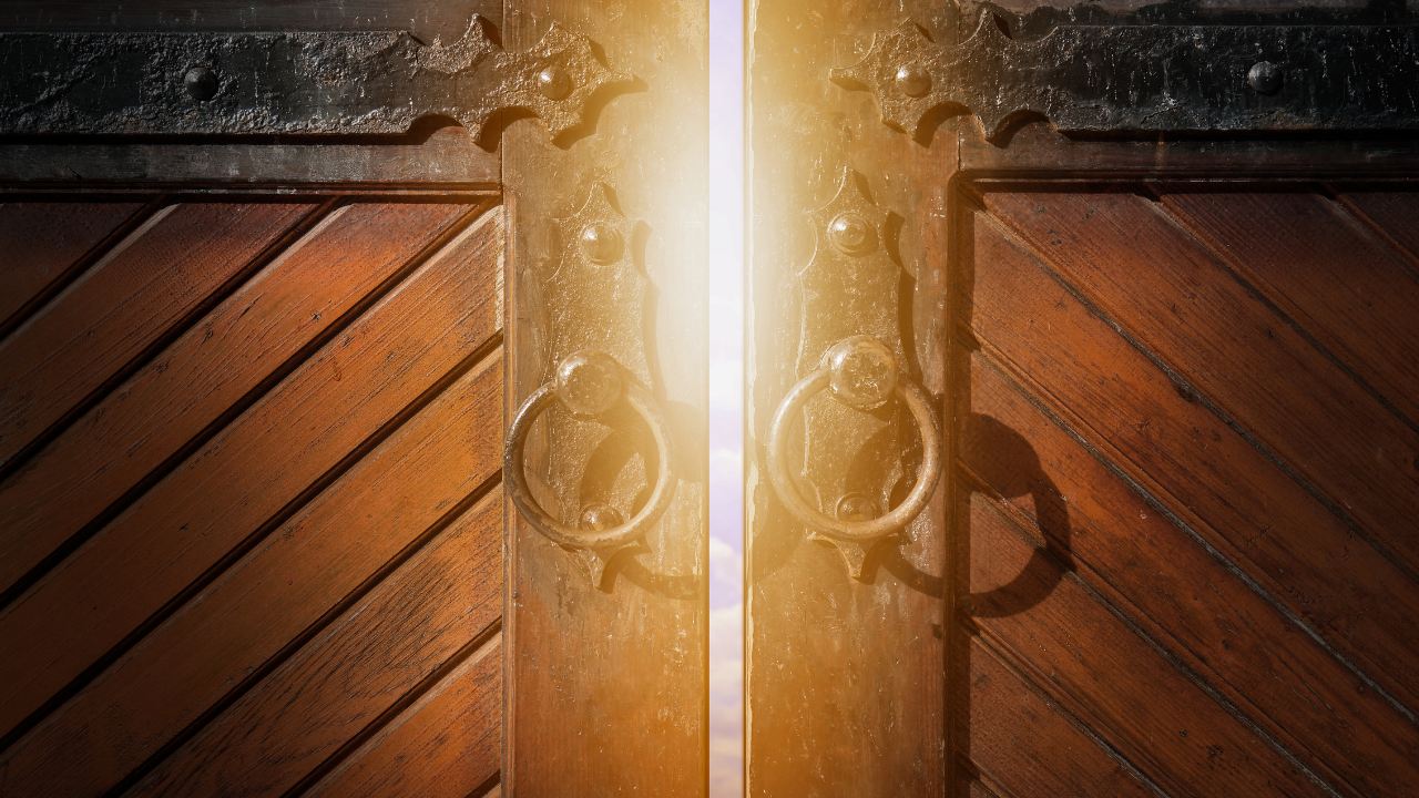 A closed door with light streaming through it ready to open - when your purpose comes knocking, answer the door!