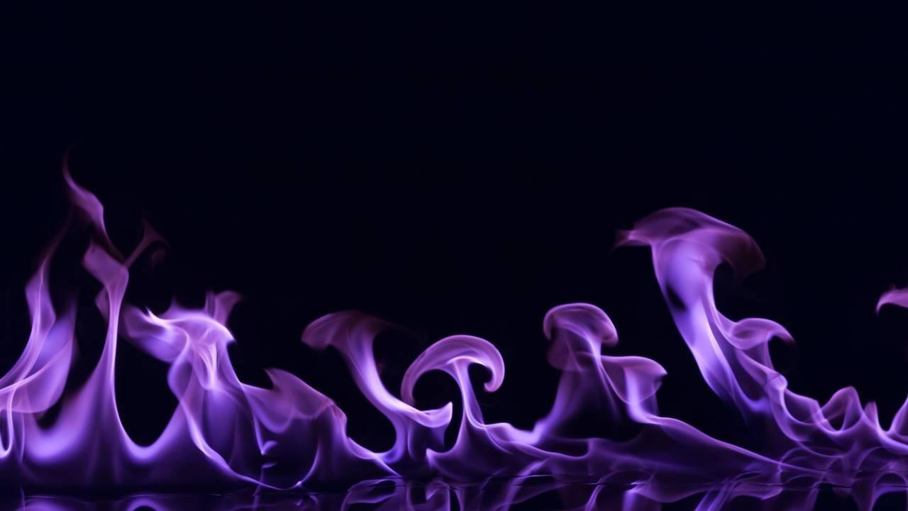 Purple fire on a black background - let your fire out to supercharge your soul-aligned empire