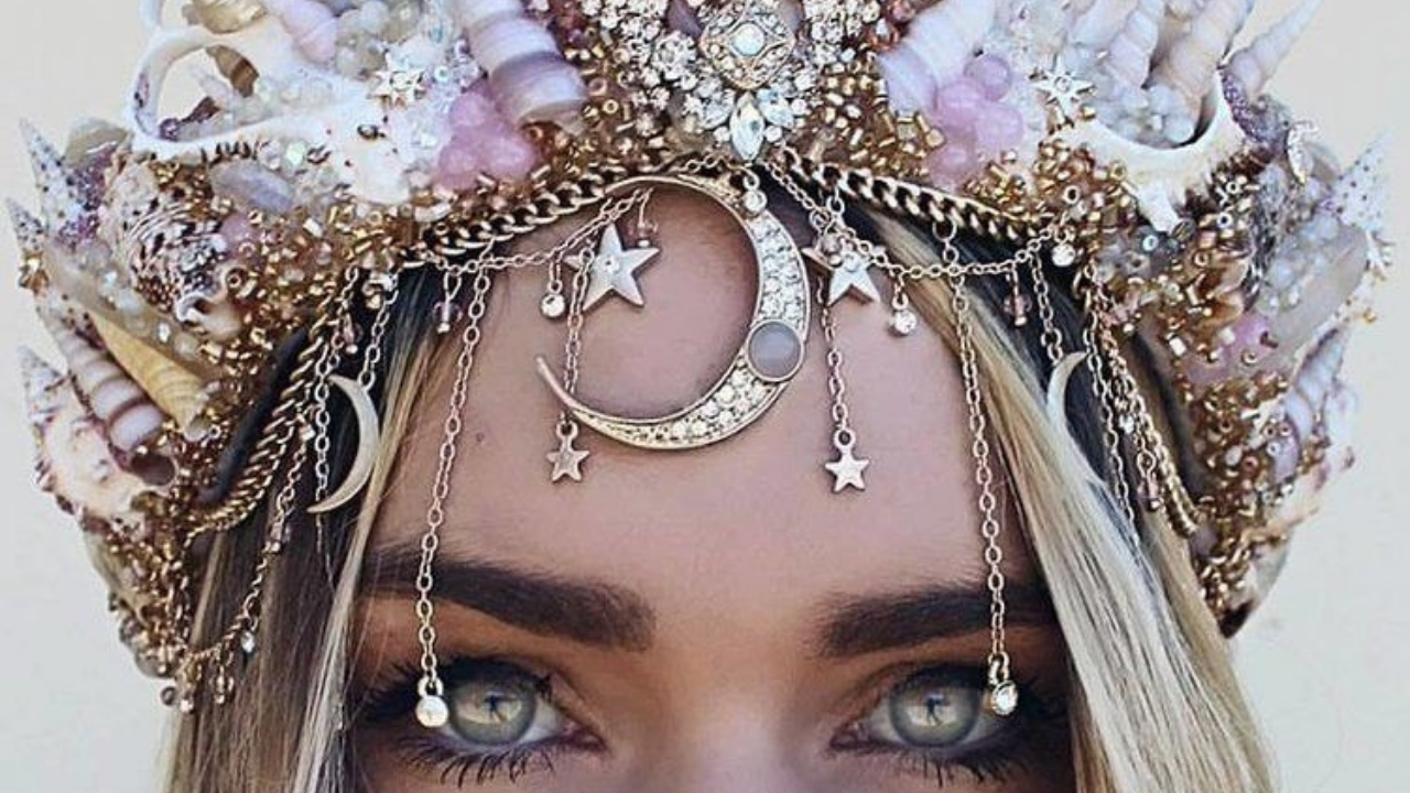 Priestess woman wearing crown of shells, moon and stars - remembering who you are and your unique soul's truth