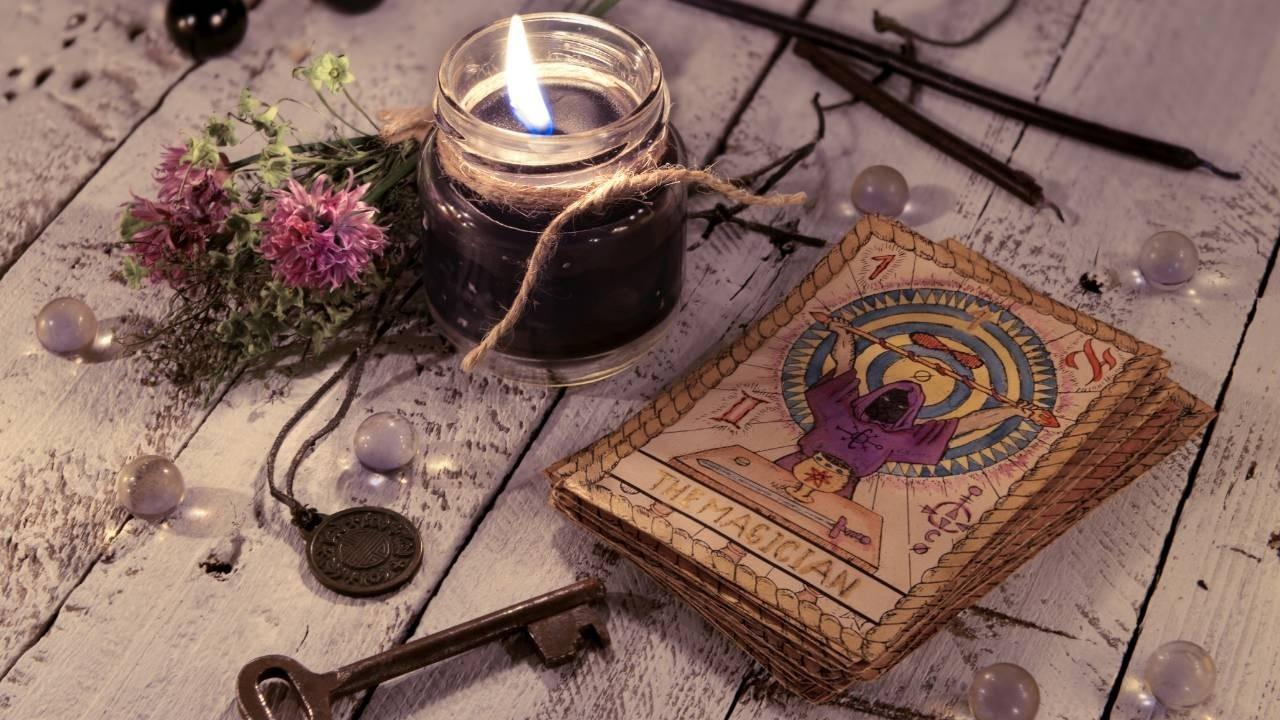 Learn how to read tarot cards - old deck of tarot cards with candle and old key