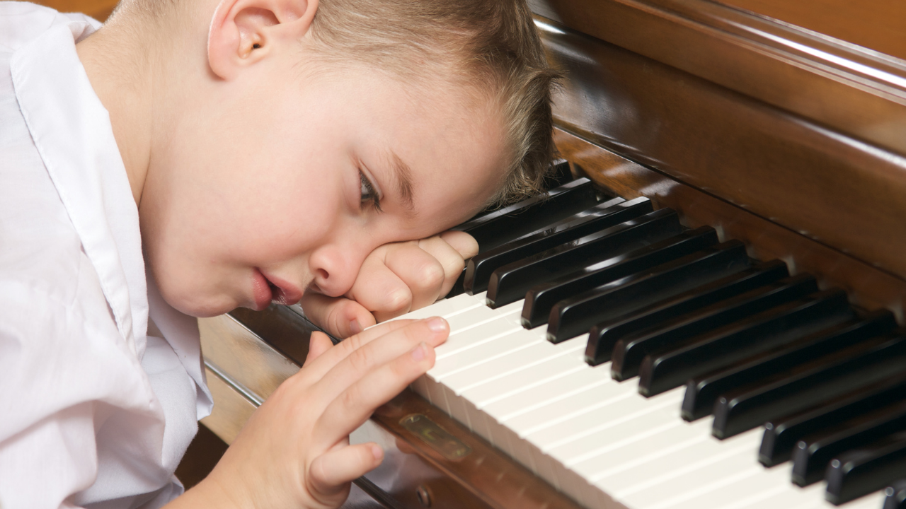 Overwhelmed child at piano