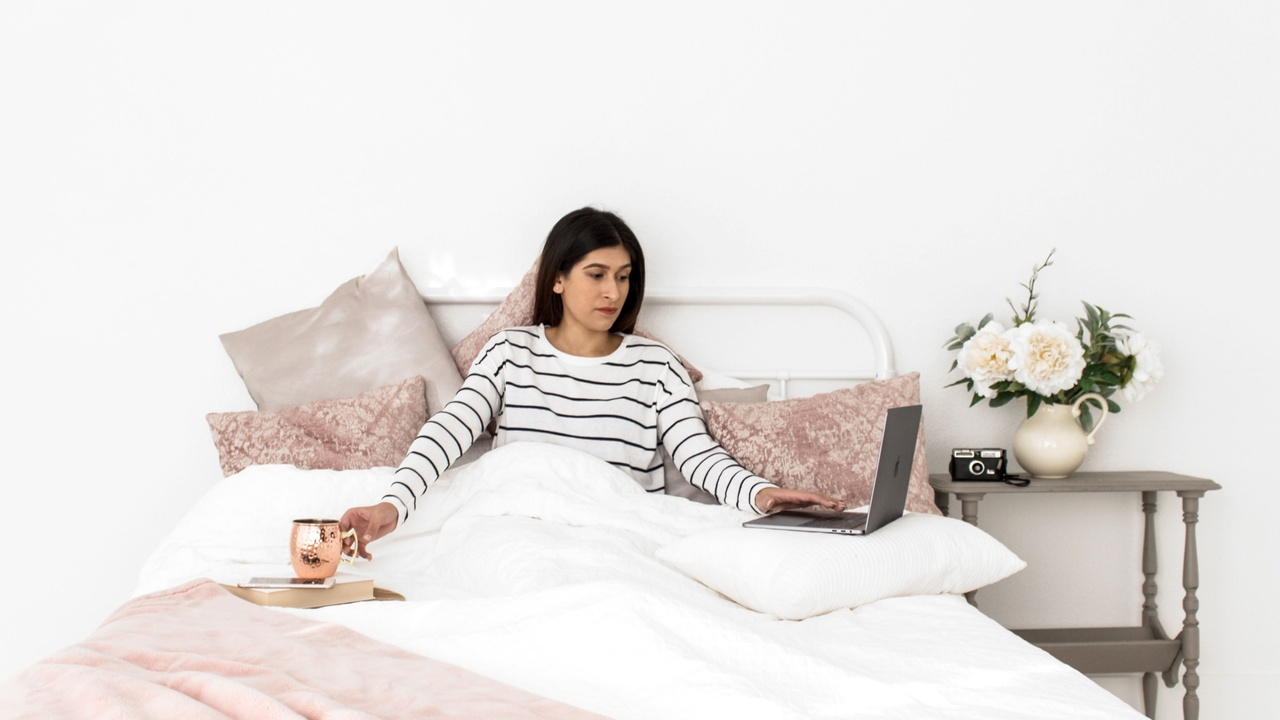 woman working from her bed