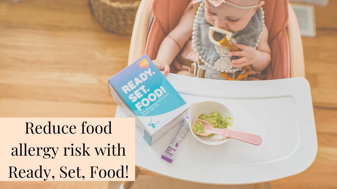 Baby sitting in high chair with bowl of pureed avocado, plus box of Ready, Set, Food! and powder sachet on high chair tray.