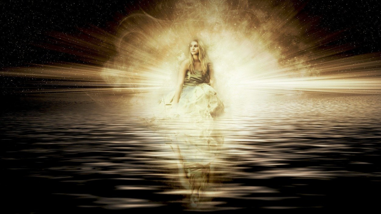 woman glowing brightly from within, reflecting in water