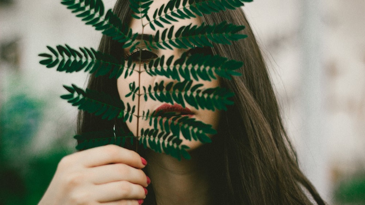 leaves and woman's face