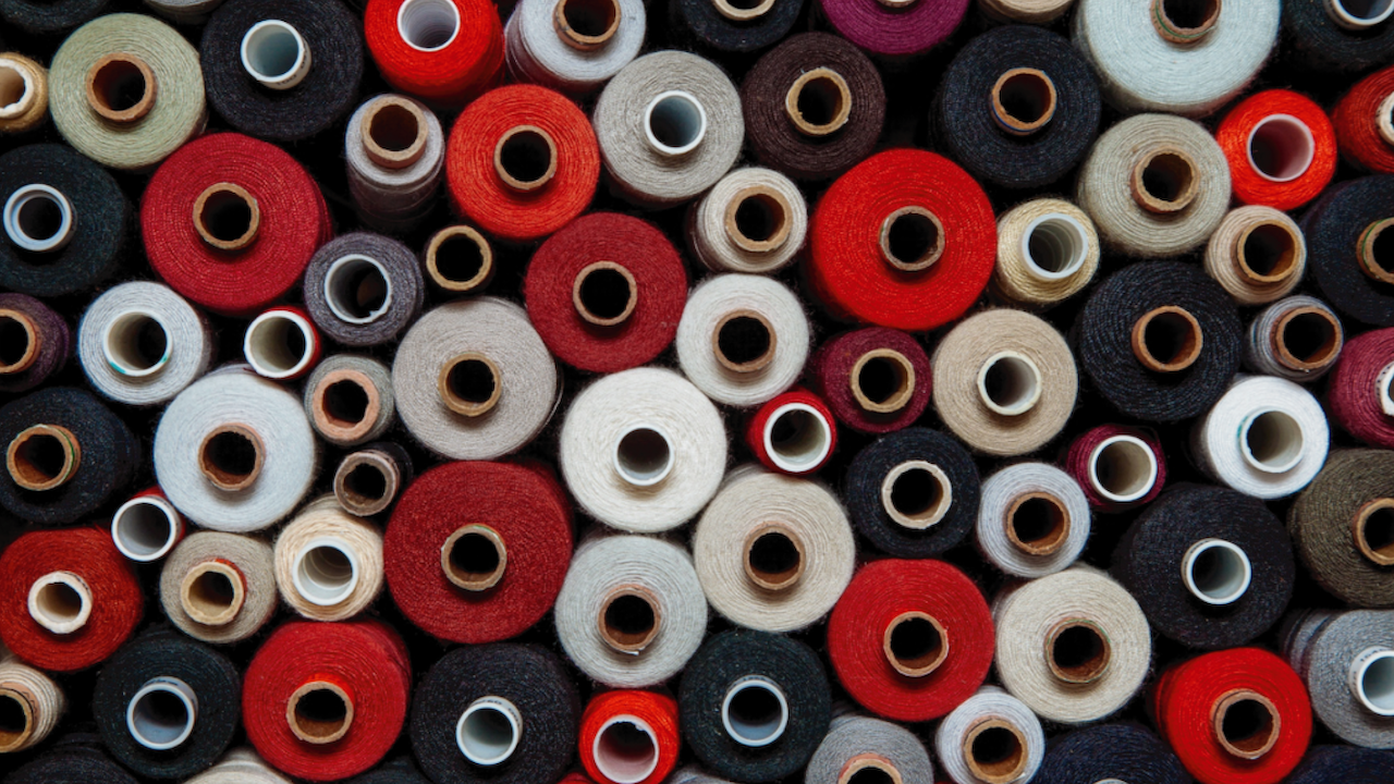 Stack of colourful fabric rolls in textile industry