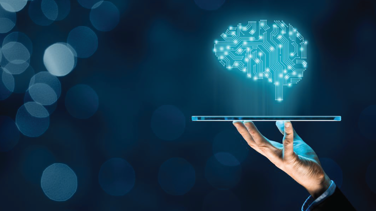 Brain representing artificial intelligence and businessman holding futuristic tablet