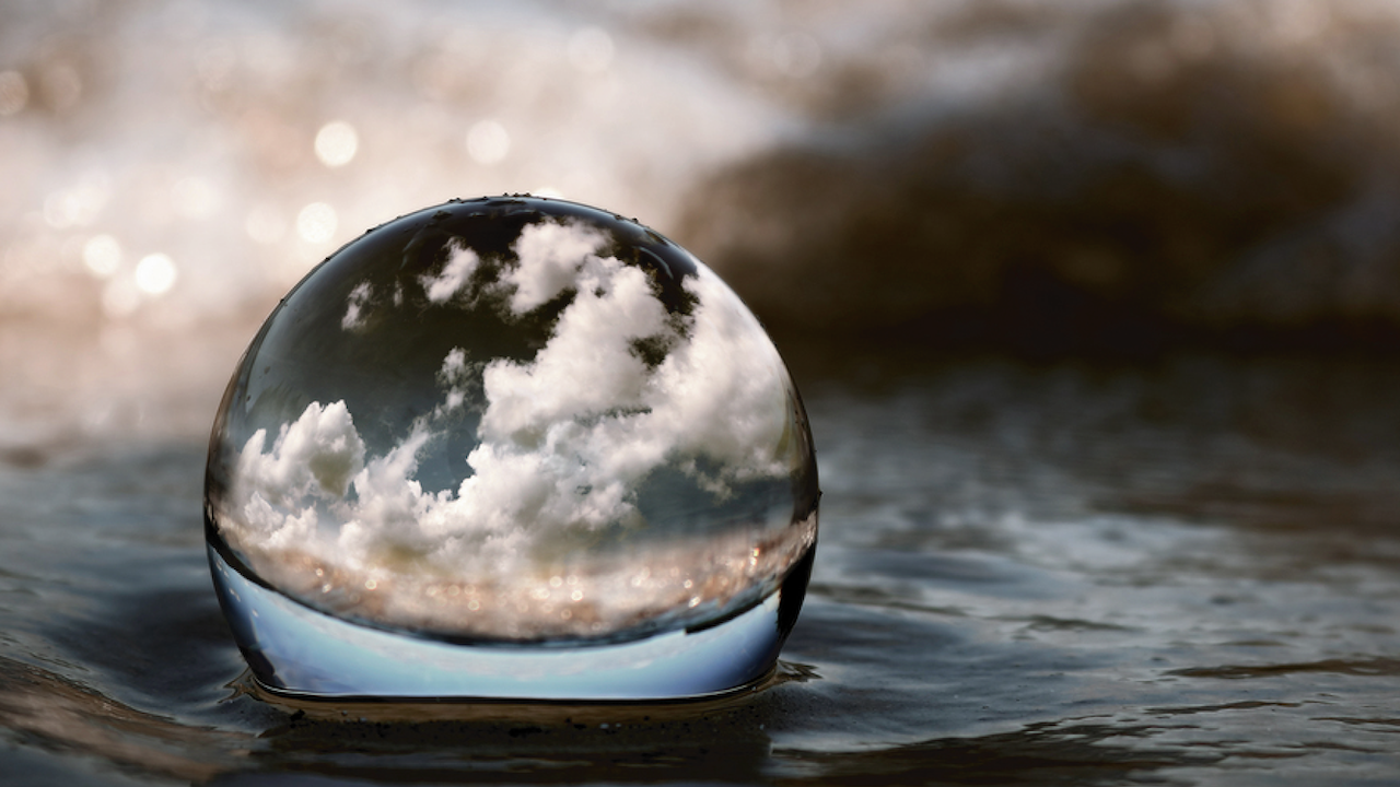 Reflection of world in water droplet. Concept of transparency.