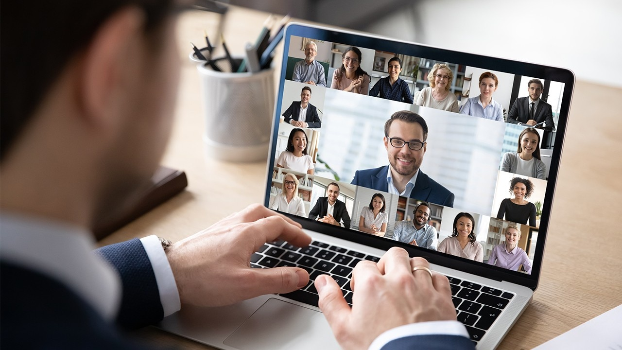 Virtual work with team on laptop computer