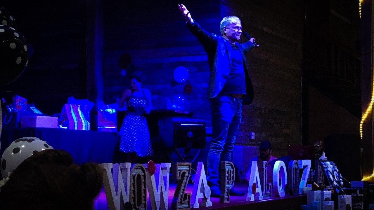 Dr. Tim speaking at his company-wide event, Wowzapalooza.