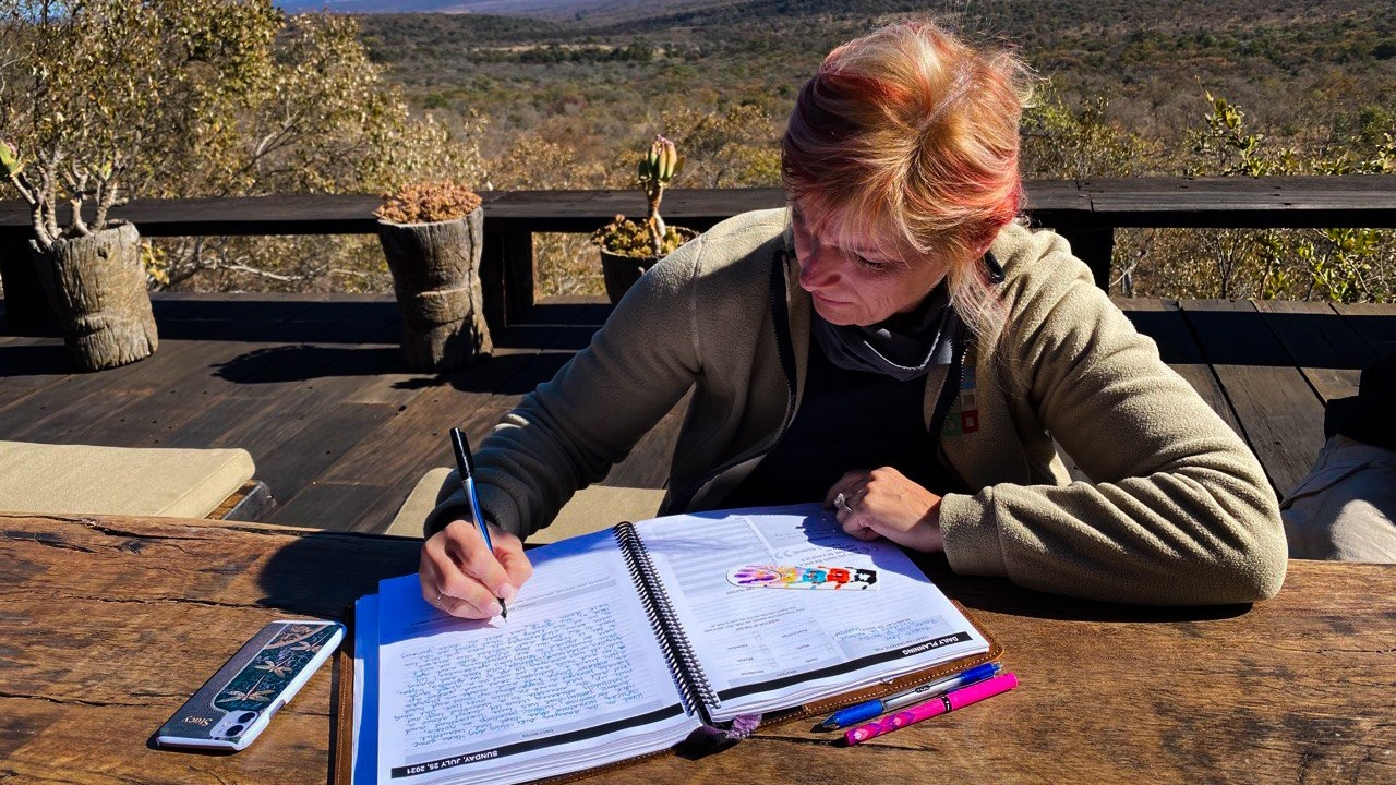 Stacy Calvaruso using her planner in South Africa.
