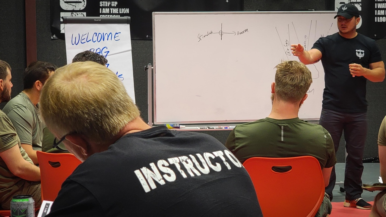 Gladiators listen to instructor Spencer at Dr. Tims event in Atlanta, TX.