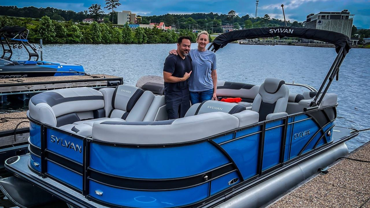 Billy and his wife, Barbara, take a picture on their new boat.