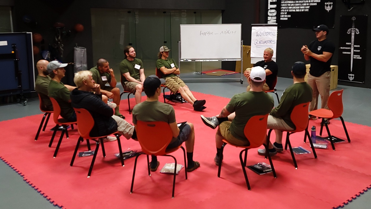 A group of Gladiators listening to instructor Spencers class at Reynolds Ranch in Atlanta, TX.