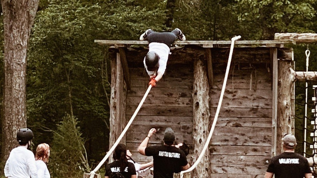 A Valkyrie attendee tackles the obstacle course with the support of her fellow sisters and Cadre.