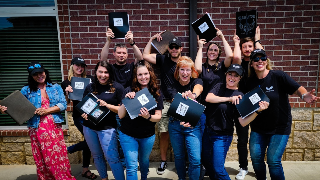 A group of Valkyrie and Gladiator planner users pose with their Living Every Minute planners.