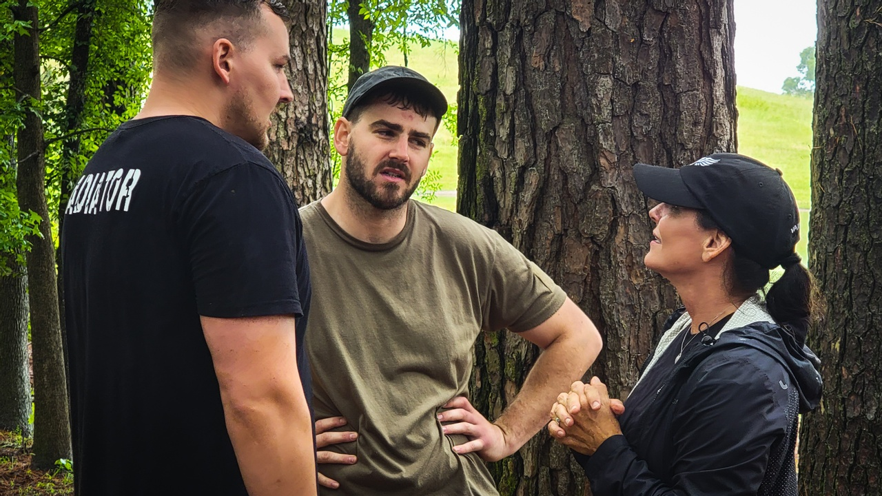 Instructor Tracy speaks with a member of the event Cadre and a gladiator during a Gladiator event at Reynolds Ranch in Atlanta, TX..