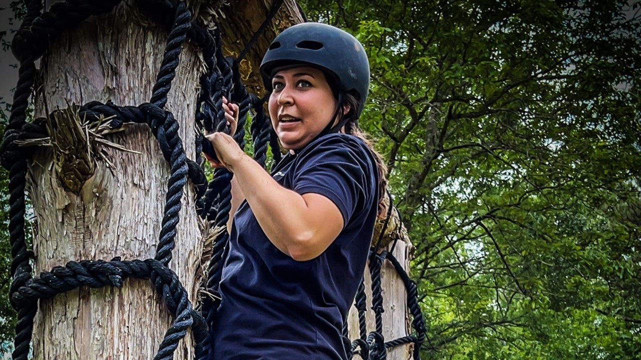 Jennifer Reynolds (Valkyrie) climbs an obstacle, overcoming a fear, on the Reynolds Ranch in Atlanta, TX.