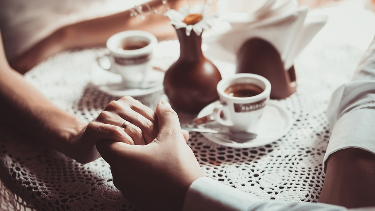 hand holding coffee cups