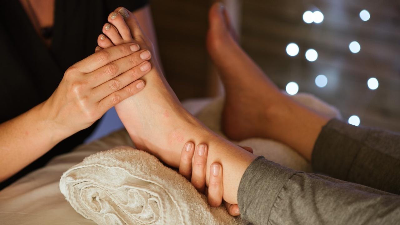 woman using vita flex points on feet