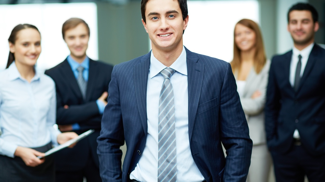 successful leader in room with employees