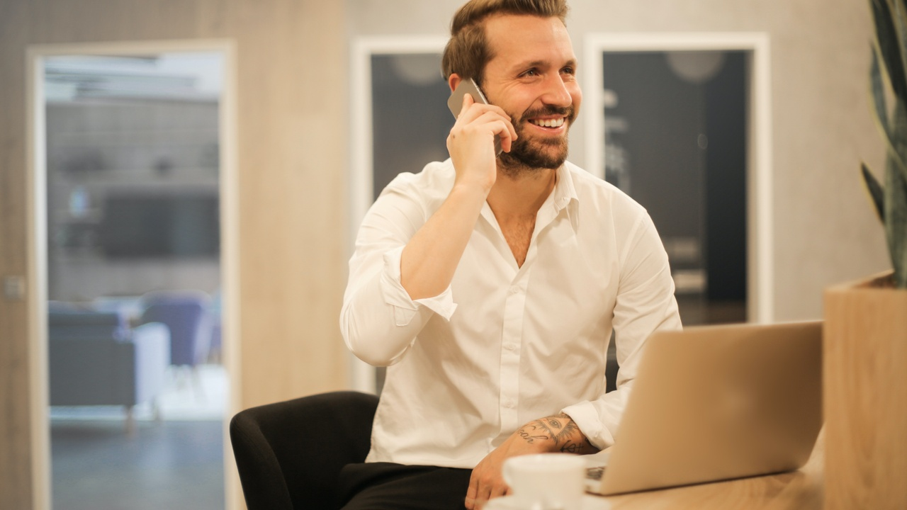 Businessman networking on phone