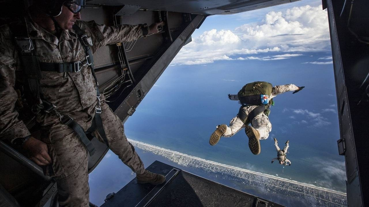 U.S. Military skydiving out of a plane