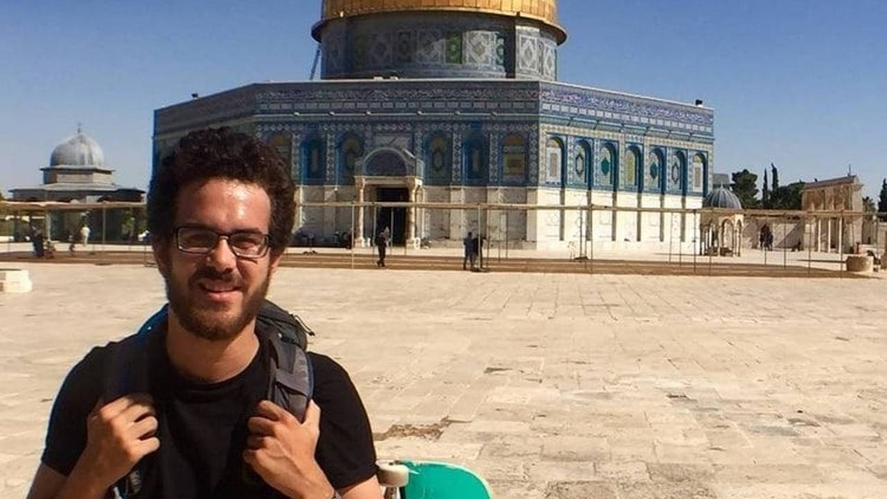 Ahmed Mousa standing infront of a building
