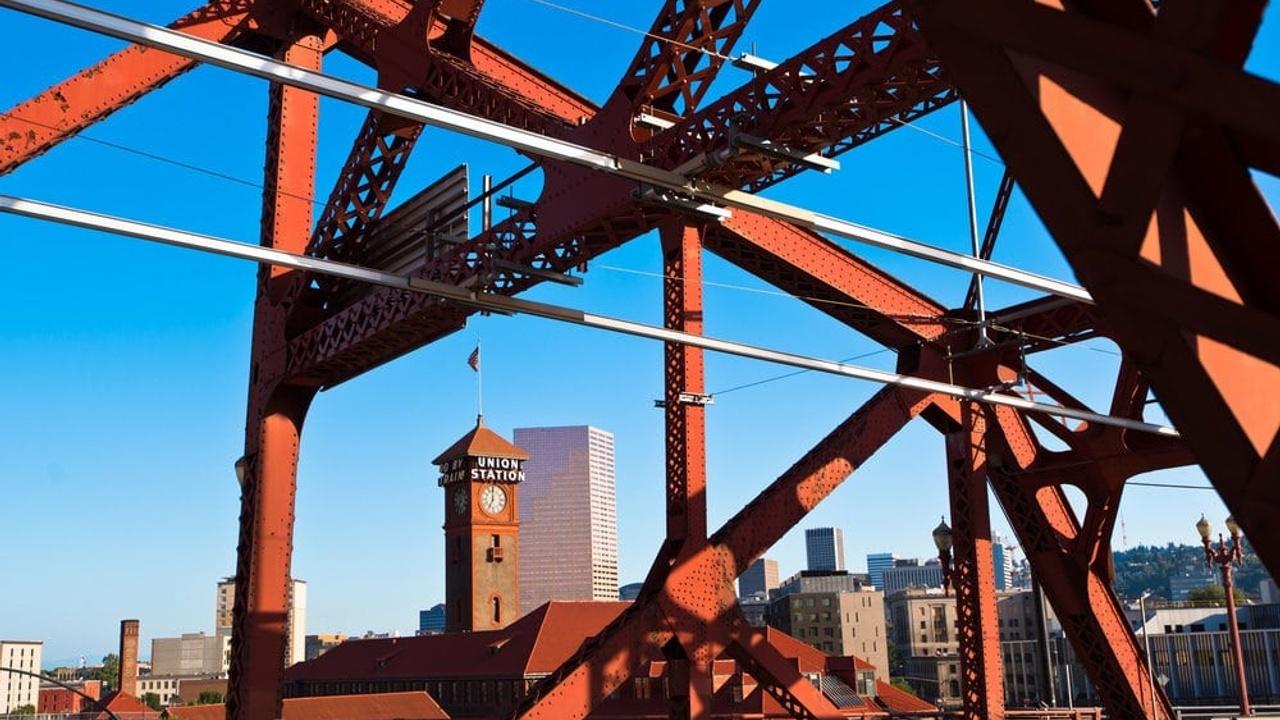 View of downtown Portland through metal truss of bridge