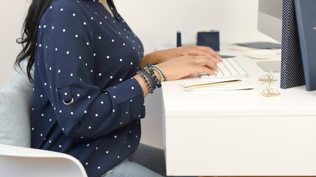 why kajabi site needs blog woman at desk using keyboard