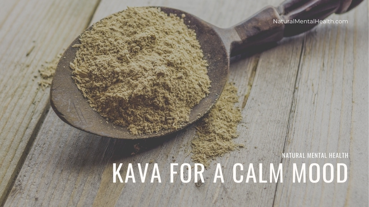 Kava for a Calm Mood | A spoon on a wooden table holding tan powdered Kava.