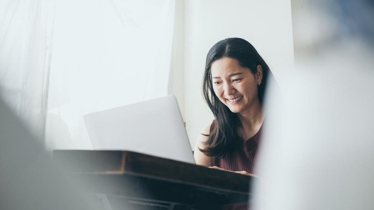 smiling woman on laptop