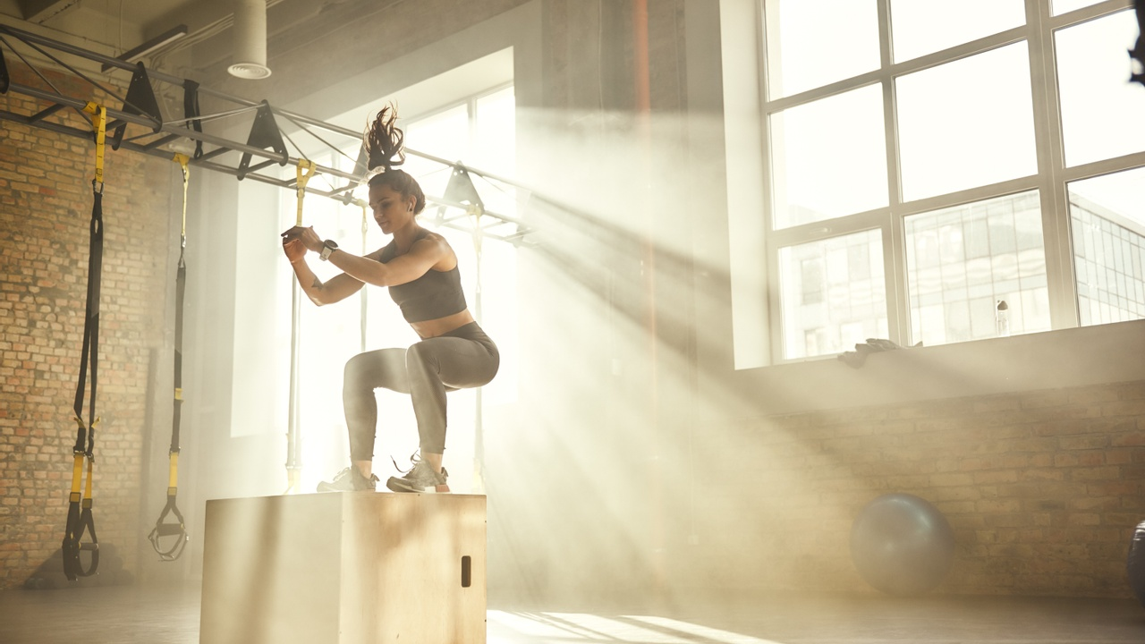 cover image of female athlete doing box jumps