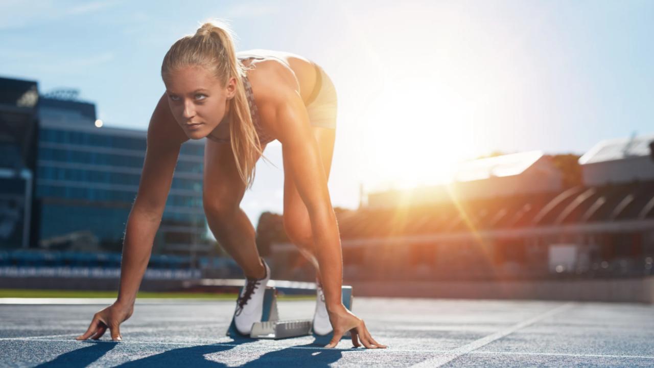 Female athlete preparing to sprint