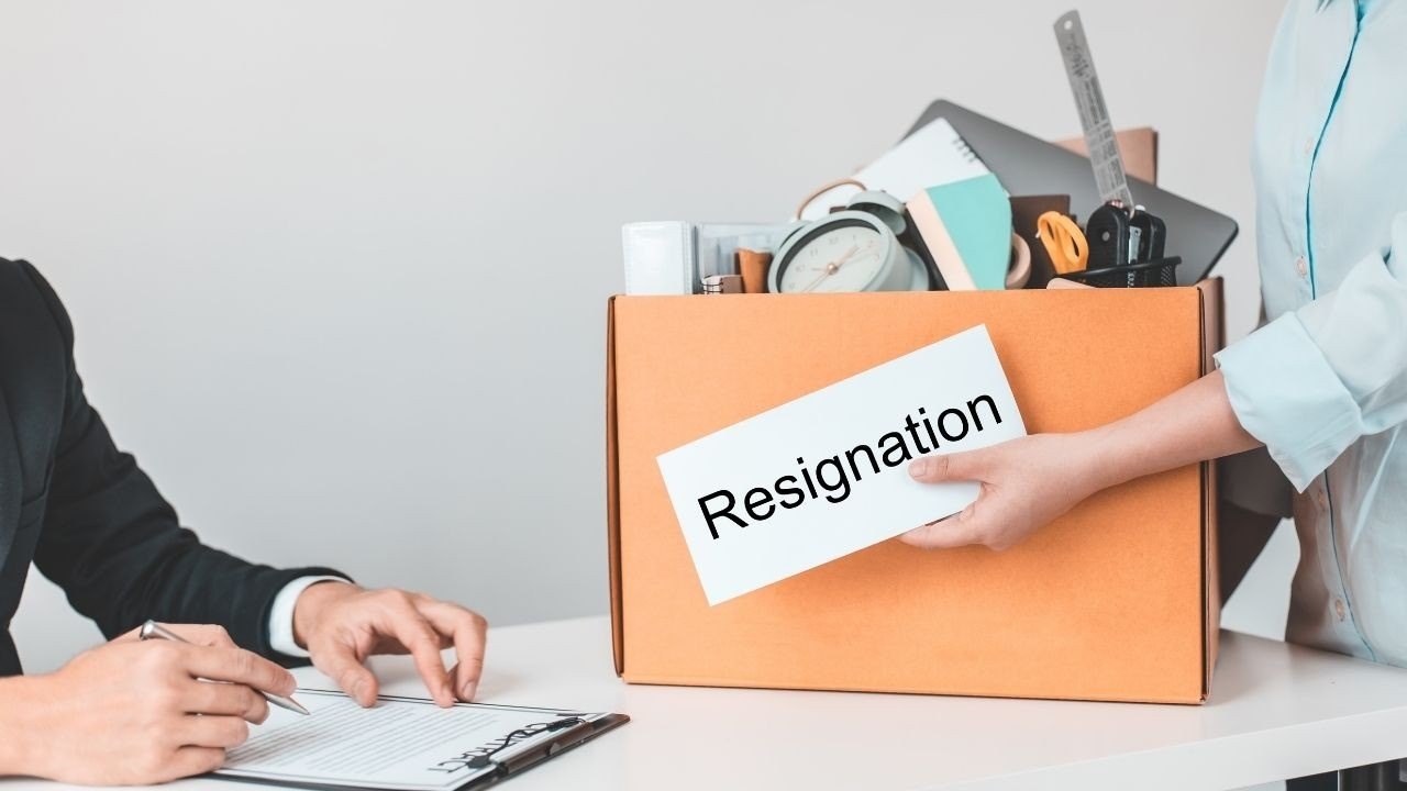 Image of a professional presenting resignation at the office desk