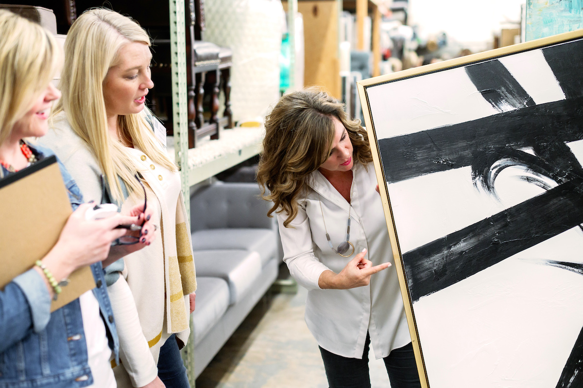 Picture of a home stager showcasing an art piece
