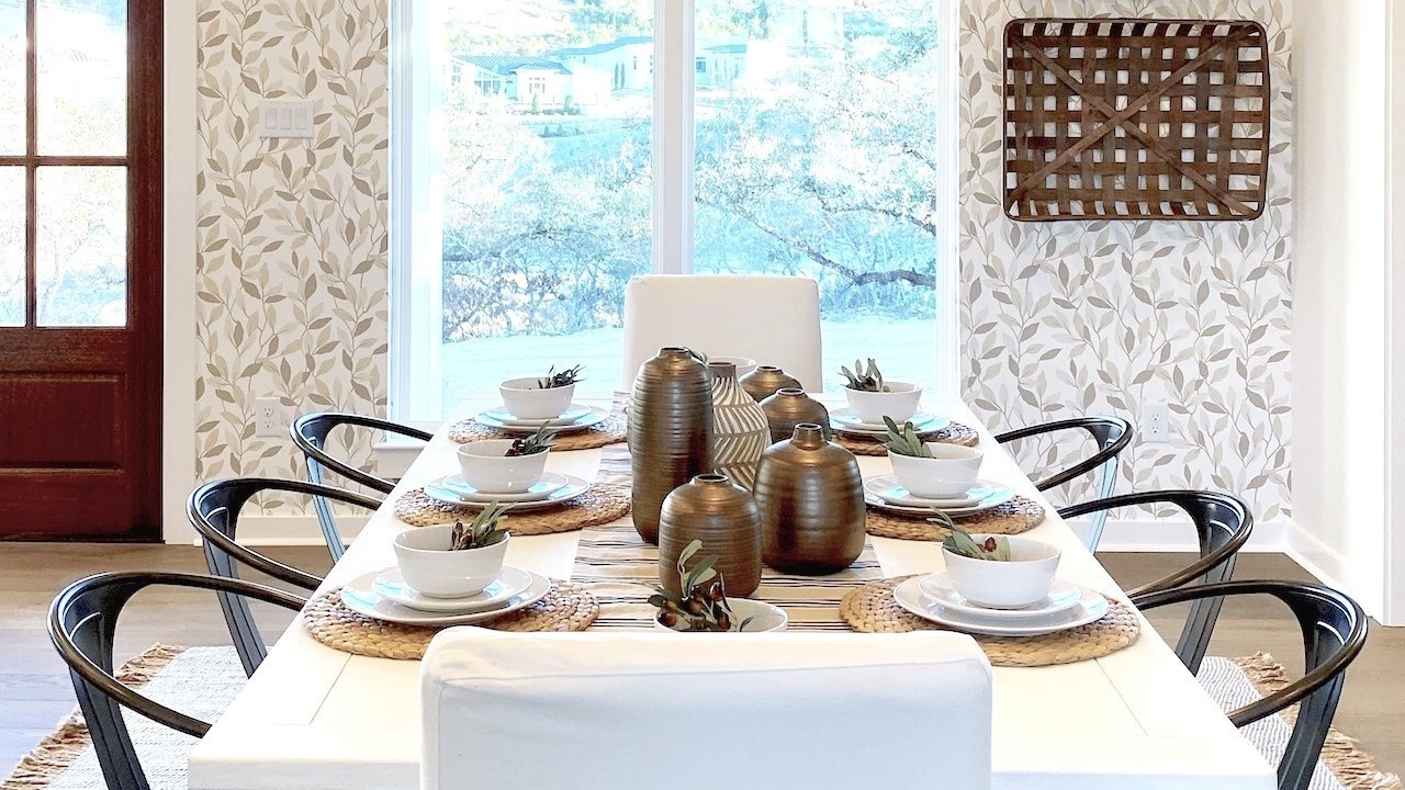 How Do I Become a Home Stager - Photo of a farmhouse-style dining room with vine leaf wallpapered walls