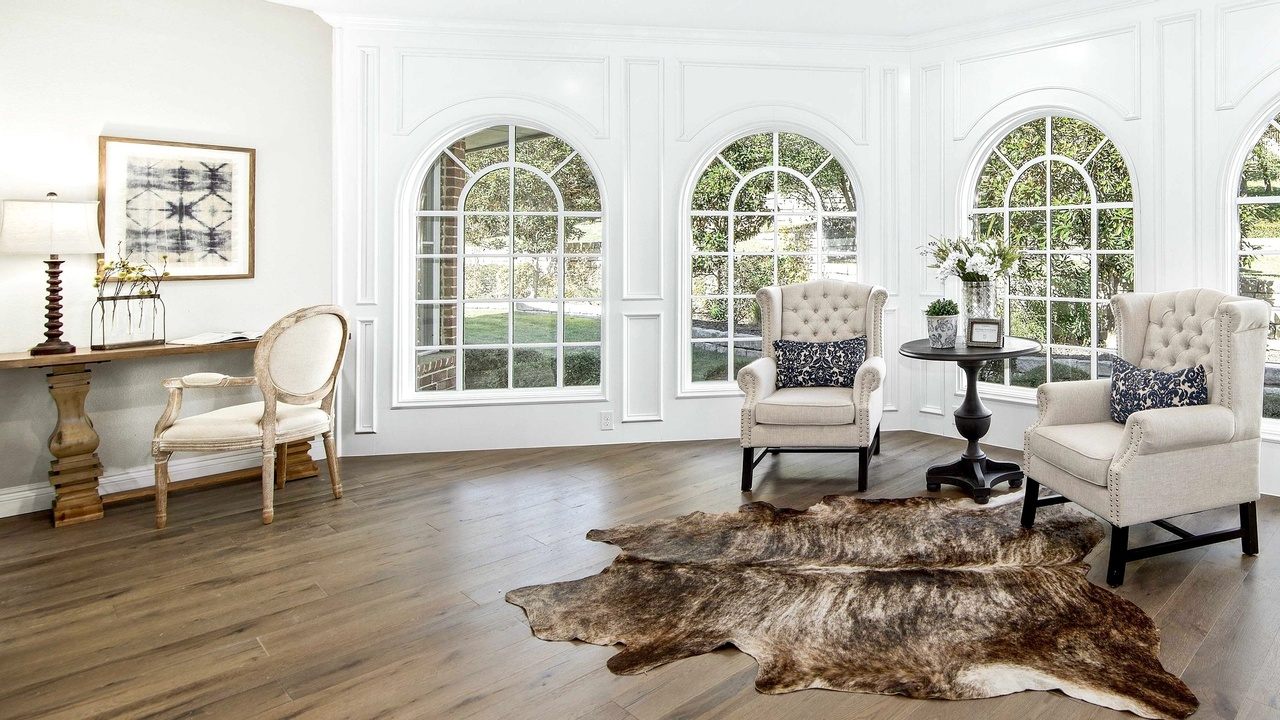 A staged home for sale with cowhide and arched windows. 6 Reasons Why You Should Stage in a Hot Real Estate Market