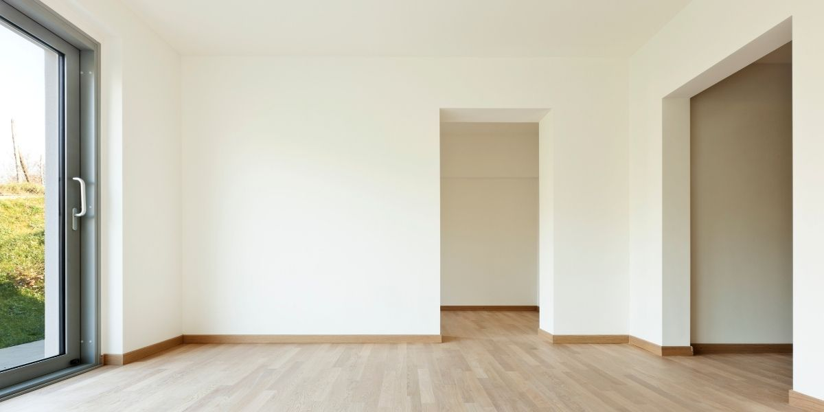 picture of empty vacant living room with white interior