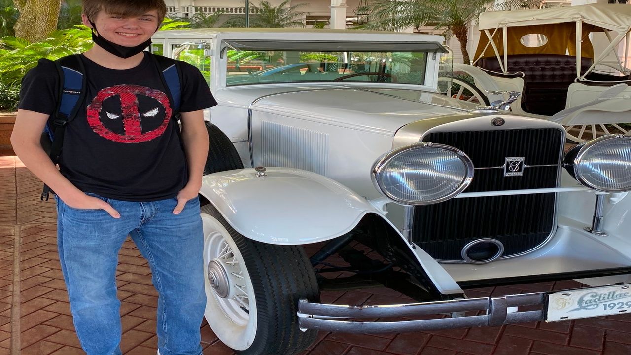 Mikey with an old Cadillac