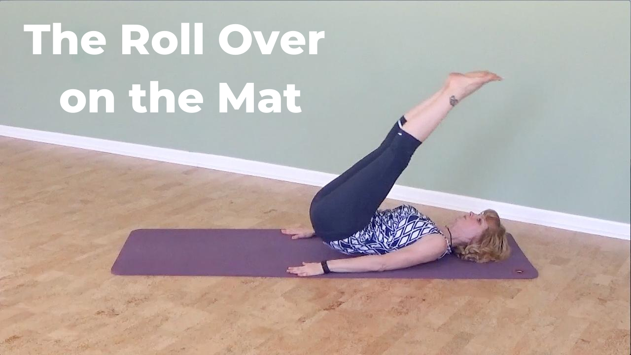Roll over on the Mat to mobilize the spine into flexion