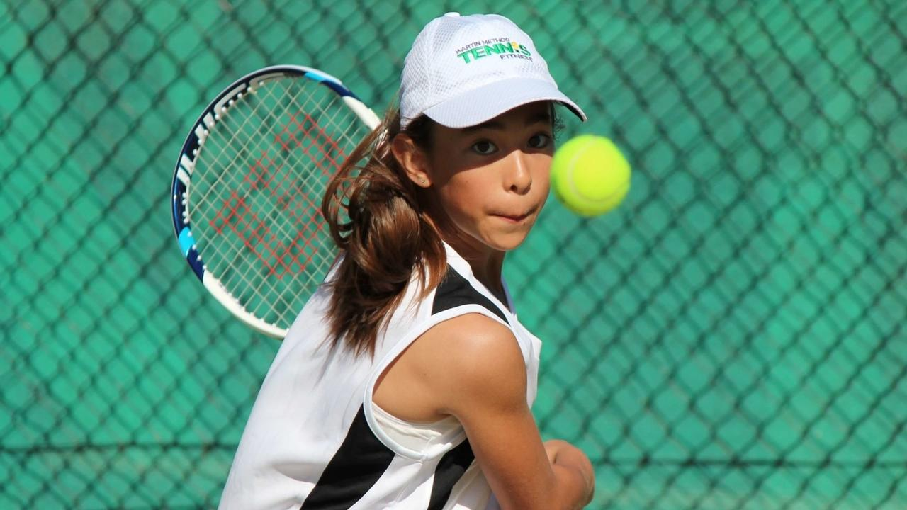 Image of junior tennis playing training