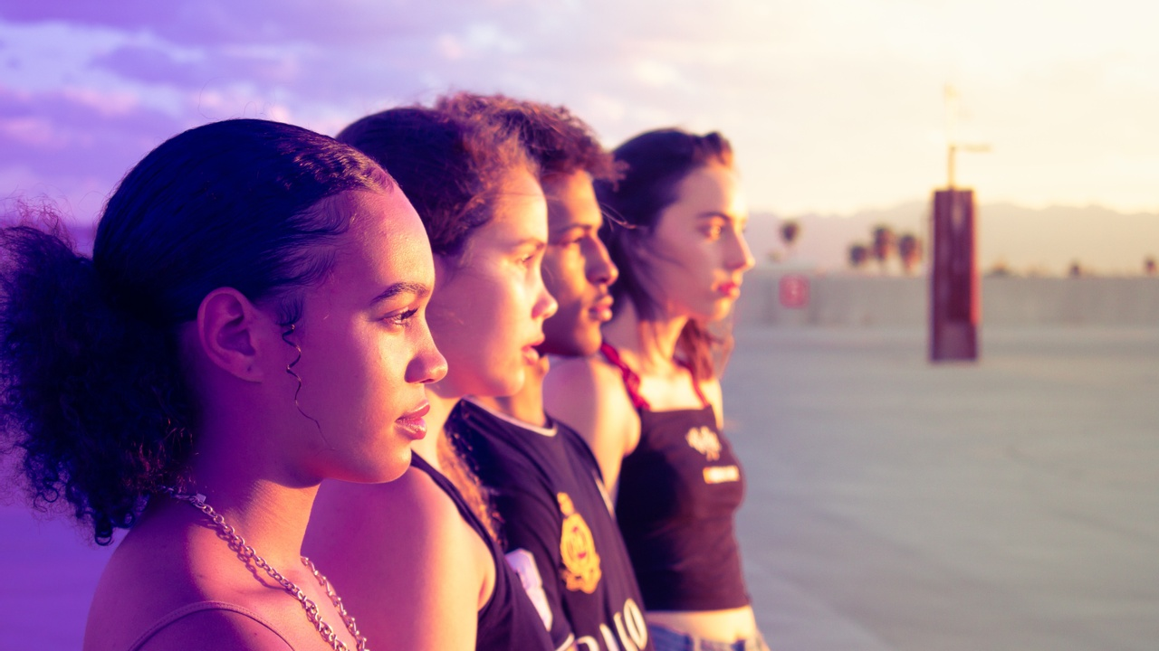 Four young people looking into distance