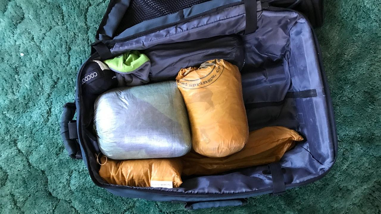 camping gear in carry on luggage for easy travel