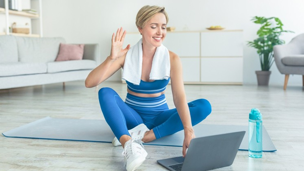 Pilates client beginning her Online PIlates session with her Pilates Teacher