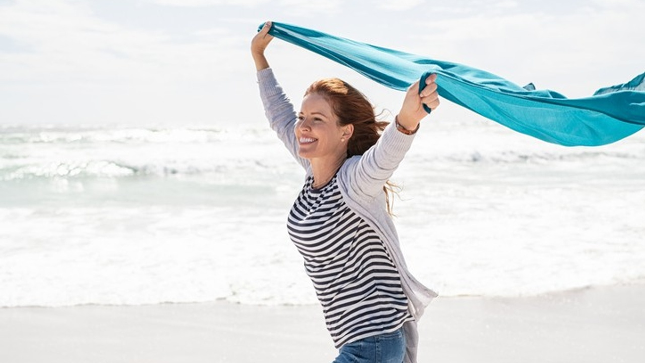 This woman had back pain but thanks to her Pilates training she is now pain free and living her best life.