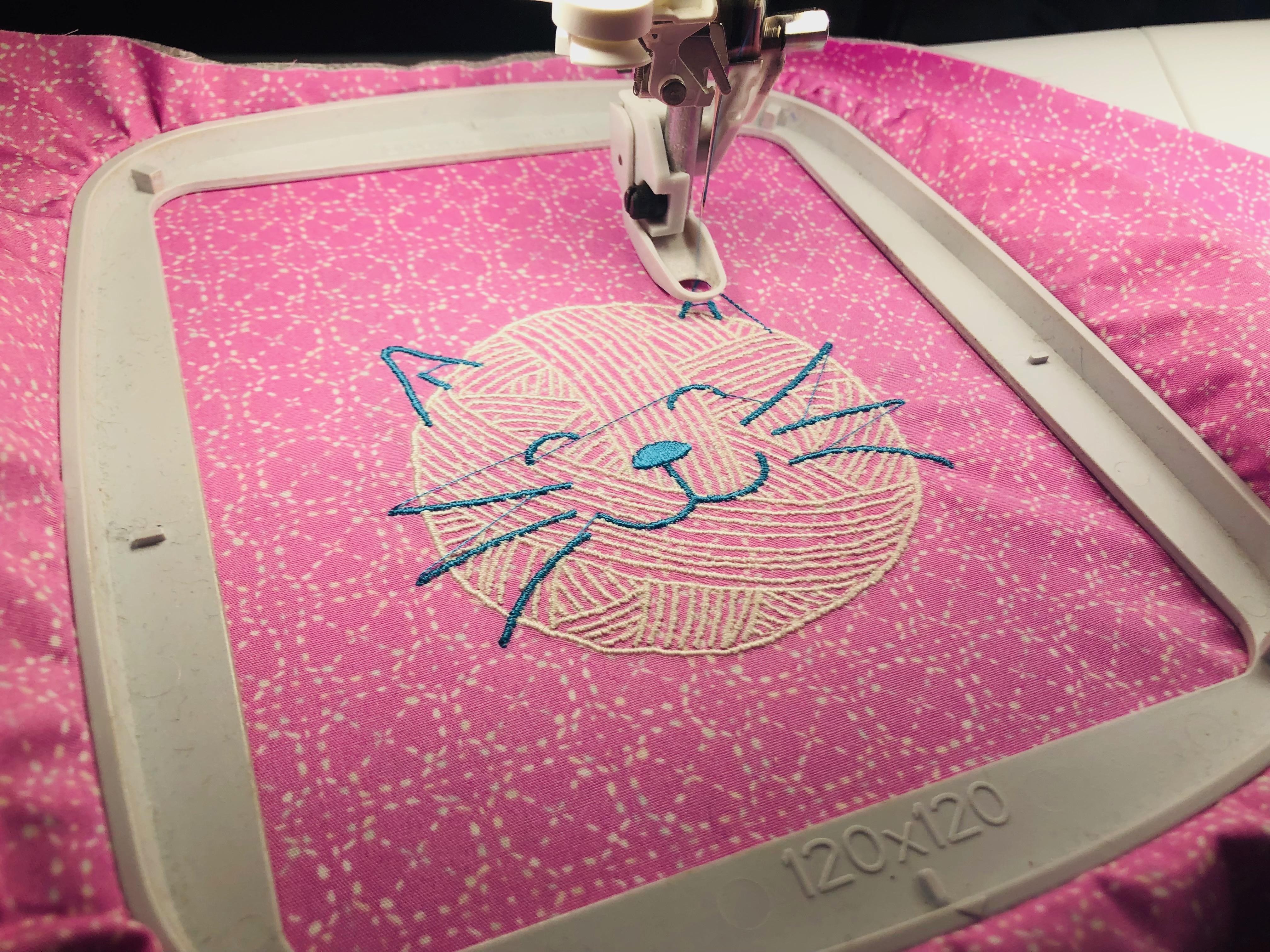 yarn cat embroidery on zippered organizer
