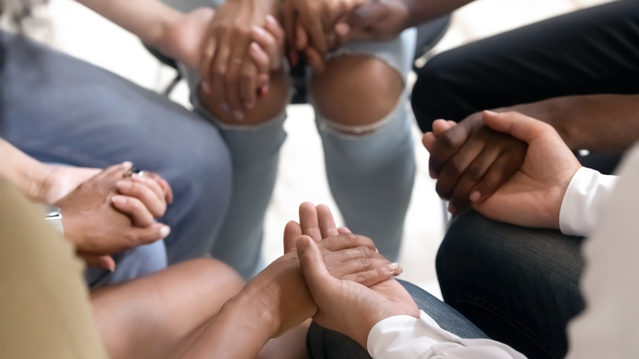 H1xv1jyzsgyfaortmxcx diverse people sitting in circle holding hands at group therapy 1139791216 2125x1416